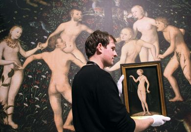 An employee of the Städel Museum gives Venus by Lucas Cranach the Elder the white-glove treatment