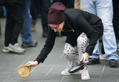 woman drops pancake