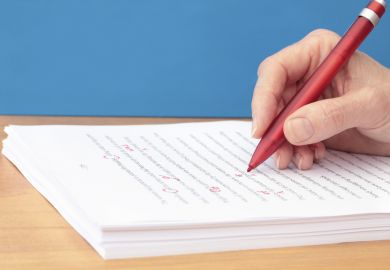 manuscript-being-corrected-red-pen