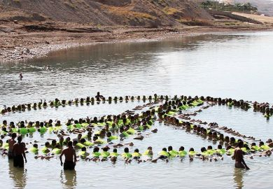 people make the shape of a peace sign in the water