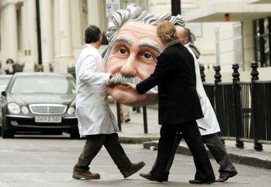 People carrying model of Albert Einstein's head, Science Museum, London, England
