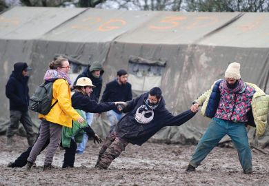 People help man stuck in mud at music festival, Notre-Dame-des-Landes, France