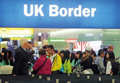 People queuing at UK border, Heathrow Airport, London