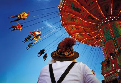 People riding on fairground ride