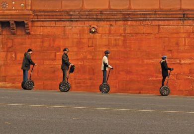 People riding Segways past Indian Home Ministry, New Delhi