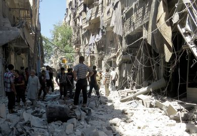 People standing among rubble of destroyed buildings, Aleppo, Syria