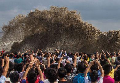 People taking photos of tidal waves, Typhoon Usagi