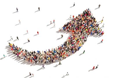 People forming growth arrow