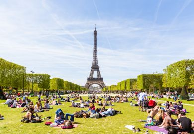 People on Champ de Mars with Eiffel Tower in background