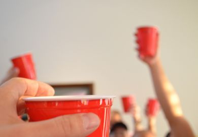 People toasting using red party cups