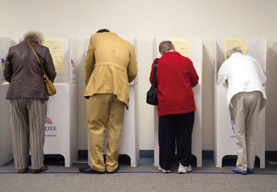 A row of people voting