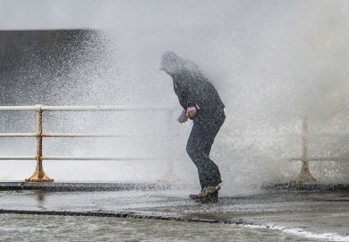 Person caught in spray of wave, Worcester, England