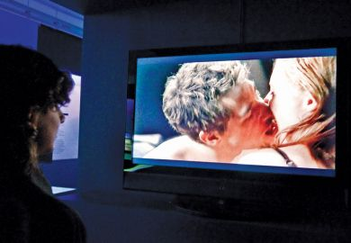 Person watching sex scene on television screen, Museum of Sex, New York City