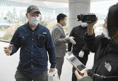 Peter Daszak (left), a member of the WHO team investigating the origins of the coronavirus pandemic, speaks at Wuhan's airport in China on February 10, 2021, at the end of the WHO mission