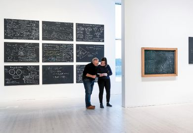 Chalkboards with equations by contemporary physicists