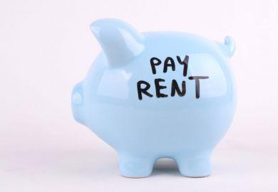 Piggy bank saying 'pay rent'