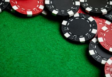 Pile of casino chips on gambling table