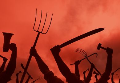 Arms holding up pitchfork and other implements