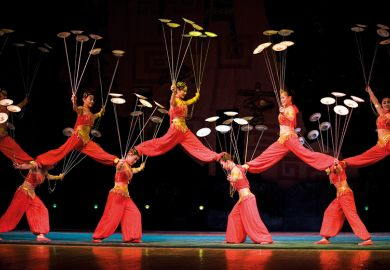 Acrobats spinning plates
