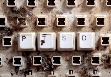 Post-traumatic stress disorder (PTSD) spelled on dirty, broken keyboard keys