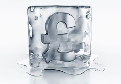Pound currency symbol frozen in ice block