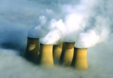 Power station chimneys engulfed in fog