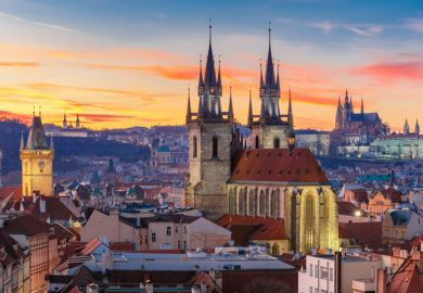 View over Church of Our Lady before Tyn, Old Town and Prague Castle at sunset