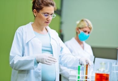 Pregnant woman doing lab work