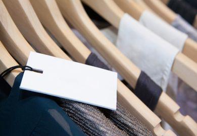Price label on rack of designer clothes