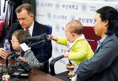 Robert Kelly with his wife Jung-a Kim and children Marion and James, who interrupted his live TV interview on South Korean politics