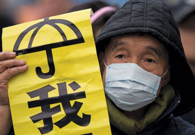 Protestor holding banner, Admiralty District, Hong Kong