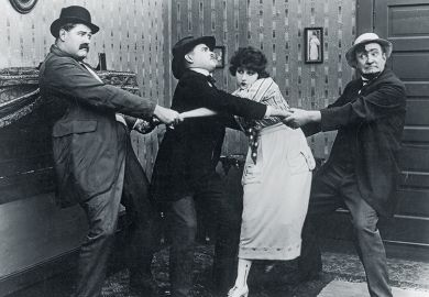 Four people pulling each other