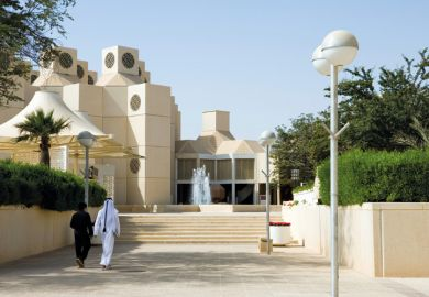 Qatar University students walking on campus