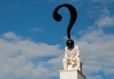 Statue of figure with question mark as head