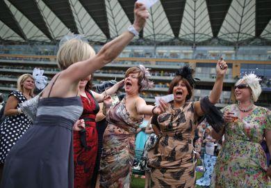 Racegoers celebrate win, Royal Ascot, England