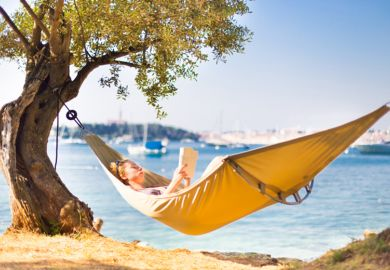 A person reading in a hammock