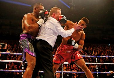 Referee punched in boxing match
