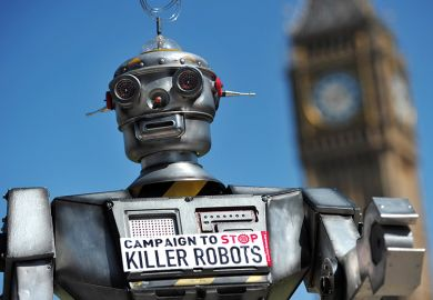 A robot wearing a sign saying 'Campaign to Stop Killer Robots'