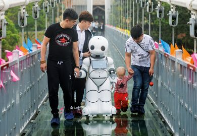 People with robot on bridge