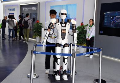 Young Asian man with robot