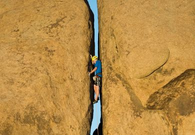 Rock climbing narrow crevice