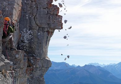Rocks falling with cliff climber