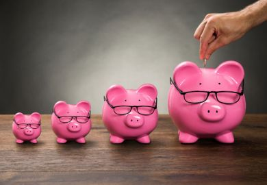 Row of increasing-sized pink piggy banks