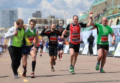 Runners crossing the finish line, Brighton Marathon 2016
