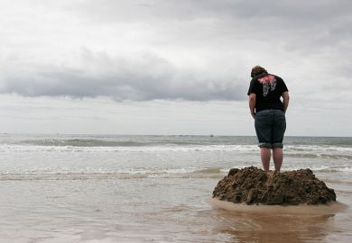 sandcastle with rising tide