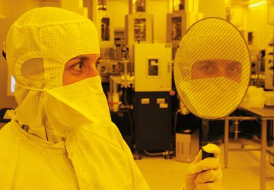 Scientist holding wafer with 667 'Eyescreens', Dresden, 2007