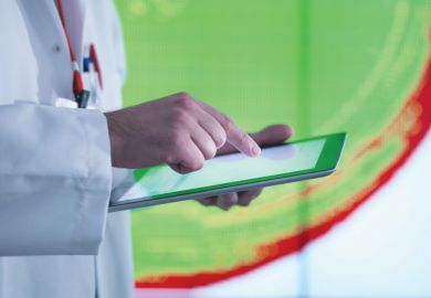 Scientist working with touchscreen tablet device
