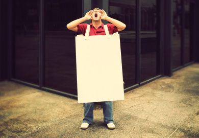 Screaming man wearing sandwich board in street