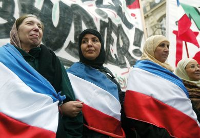 Muslim women protest against the proposal to ban headscarves in French state schools