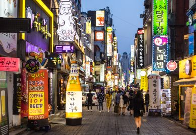 Seoul, South Korea - May 13, 2017 People wander in the busy streets of the Insadong entertainment district lined with bars and restaurants at night